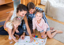 Family with board game at home Stock Image