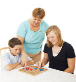 Family Board Game - Mom Helps royalty free stock image