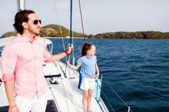 Family on board of sailing yacht. Father and daughter on board of sailing yacht having summer travel adventure royalty free stock photos