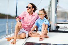 Family on board of sailing yacht. Father and daughter on board of sailing yacht having summer travel adventure stock photography