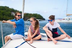 Family on board of sailing yacht. Father and kids on board of sailing yacht having summer travel adventure royalty free stock photos