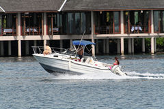 Family boat. Passing in front of a ressort Royalty Free Stock Photography