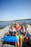 Family in a boat royalty free stock images