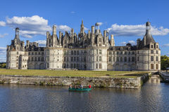 Family on a Boat in Front of Chambord Castle stock image