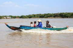 Family on boat near floating village on tonle sap lake , near siem reap, cambodia. Royalty Free Stock Photography