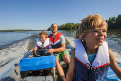 Family boating together royalty free stock photo