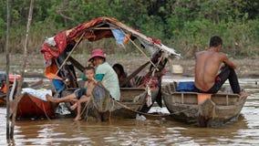 Family in boats, Tonle Sap, Cambodia Stock Photo