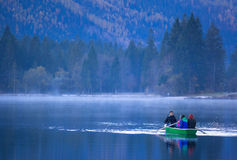 Family boattrip on hintersee on a foggy morning Stock Photography