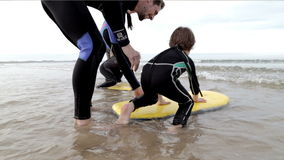 Family body boarding at the beach stock video