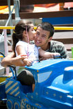 Family bonding. Brother plays with his sister at the playground Stock Image