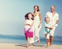 Family Bonding Running Sand Beach Summer Concept.  royalty free stock image