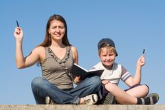 Family with book and pens Stock Photography