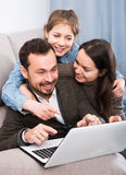 Family booking hotel online on laptop. Together at home Royalty Free Stock Photography