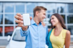 The family bought a new car in the showroom. The concept of buying a new car. Stock Images