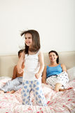 Family Bouncing On Bed Together. Smiling Royalty Free Stock Photography
