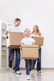 Family with boxes Royalty Free Stock Photo