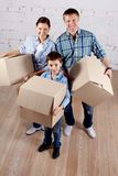Family with boxes Royalty Free Stock Photos
