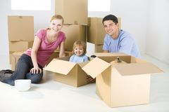 Family between boxes