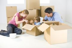 Family with boxes Stock Photography