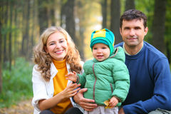 Family with boy in autumnal wood Stock Images