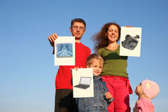 Family with boy and baby with wishes cards. On sky collage Royalty Free Stock Image