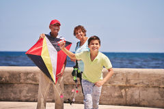 Family Boy And Grandparents Flying Kite Near Sea Stock Photography