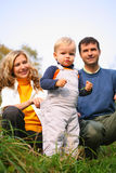 Family with boy in grass Stock Photo