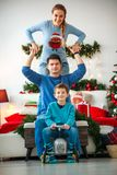 Family with boy having fun playing at home in Christmas decor. Family couple with a boy with gifts are having fun playing at home in the Christmas decorations stock image