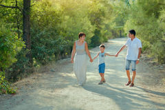 Family with boy in park Royalty Free Stock Photos