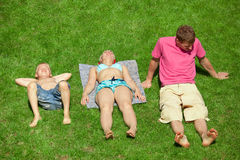 Family with boy resting on the grass, view from up Royalty Free Stock Photo