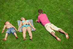 Family with boy resting on the grass, view from up Stock Images