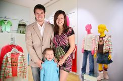 Family with boy in shop Stock Photos