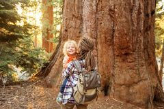 Family with boy visit Sequoia national park in California, USA.  stock photography