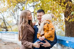 A family with a boy walking in the autumn Park happiness Stock Image