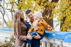 A family with a boy walking in the autumn Park happiness Royalty Free Stock Photo