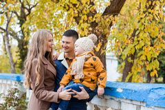 A family with a boy walking in the autumn Park happiness Stock Photo