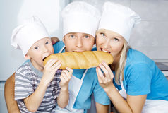 Family with bread stock photos