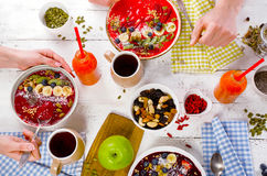 Family Breakfast with berries smoothies on a white wooden table. Stock Photos