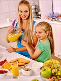 Family  breakfast with child at kitchen. Mom pours Royalty Free Stock Photos