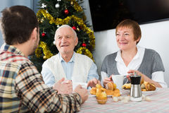 Family breakfast at Christmas table Royalty Free Stock Images