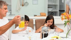 Family breakfast with orange juice and cereal Stock Photo