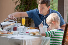 Family at breakfast stock photography