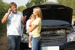 Family Broken Down On Country Road. Next to Car Royalty Free Stock Images