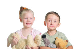 Family.Brother and sister. Boy and girl with toys isolated over white background Royalty Free Stock Images