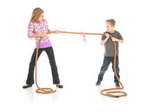 Family: Brother and Sister Battle In Tug Of War Stock Photography