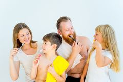 Family brushing teeth. Happy family brushing teeth in a bathroom Stock Photo