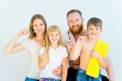 Family brushing teeth. Happy family brushing teeth in a bathroom Royalty Free Stock Photos