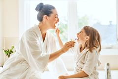 Family are brushing teeth. Happy family! Mother and daughter child girl are brushing teeth toothbrushes in the bathroom stock photos