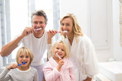 Family brushing teeth together in the bathroom. At home Royalty Free Stock Photos