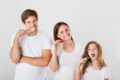 Family Brushing Teeth Together. Parent With Their Daughter Brushing Teeth Together Stock Photography